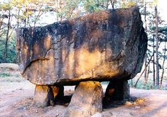 """Dolmen. Hwasun County, Korea. Dolmens are megalithic stones, found both in Europe and in Asia, that mark the burial of prehistoric elites. Those in Hwasun date to the 6th-5th century BC, later than Gochang and Gonghwa. They belong to the """"southern"""" type of dolmen, in which a capstone is supported upon a set of smaller stones and the burial is placed underground. There are hundreds of dolmens scattered around Hwasun County, between Hyosan-ri and Daesin-ri."""