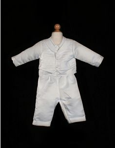 Boys Baptism Outfit style i345B by Sweetie Pie Collection is a peau satin boys pant and jacket baptism and christening set. It has cross embroidery on the jacket. Bonnet included. www.SweetiePieCollection.com