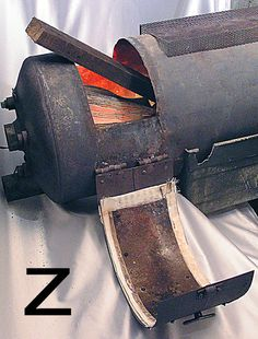 How To Convert A Hot Water Heater Into A Wood Stove - http://www.ecosnippets.com/diy/how-to-convert-a-hot-water-heater-into-a-wood-stove/