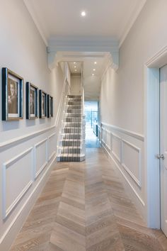Entering the property, the white tones of the hallway bring about a uniquely Victorian feeling to the place. The framed photos on the wall give the place life, a sense of homeliness — that this is not just a house, but a welcoming family home. The clear lines and design also let the beautiful chevron pattern of the floor to pop-out.