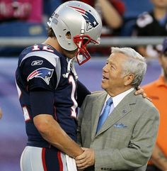 Brady being congratulated by Kraft on his completed Hail Mary pass Oct. 13.