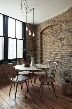 H O M E dining area - featuring the Niklas Table and Mara Chairs - SWOONEDITIONS.COM - #conceptshowroom #homebyswoon #diningroom #brickwall #springdining