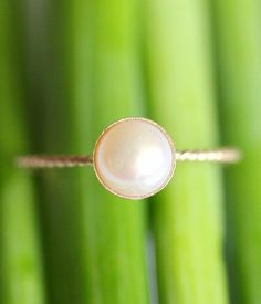 Non-Traditional Engagement Ring: Delicate Pearl Ring by Kim.  Well, that's a really pretty ring for anything.