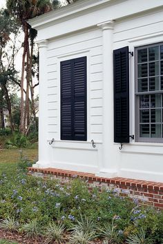 Just Fake It - Stylish Window Shutters - Southernliving. Guess what's behind these closed shutters? (Hint: It's not a window.) Shutters can be fixed inside a false opening to help achieve symmetry on a home's exterior.