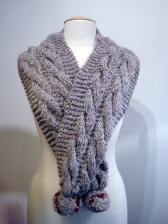 Handmade knitted beige scarf with cables and pom poms