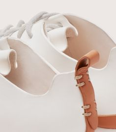 """FEIT's Runner returns to and evolves the seamless one-piece, handcrafted leather upper of the original """"running spikes"""". Built from vegetable-tanned semi-cordovan leather, the tongue is unified with the upper, so that lacing the shoe creates a folded """" Running Spikes, Purple Calla Lilies, Bare Essentials, Natural Latex, Leather Craft, Hand Sewing, Baby Shoes, Footwear, One Piece"""