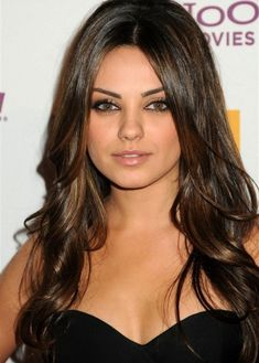 Actress Mila Kunis looks stunning with her super-shiny, dark brown layers of hair. Her shallow middle parting is very flattering for her round face shape, as her hair skims her cheeks on both sides, making her face look longer and slimmer. If you have a round face, take extra care to keep your layers well below chin length to avoid making your face look even rounder.