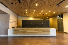 WOOD ANCHOR | Public Entrance Reception Desk - Canadian Museum for Human Rights
