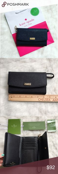 Kate Spade wristlet This is a black Kate Spade wristlet with gold accents. I own one of these and absolutely LOVE it. I love putting my iPhone 6S inside and clipping my car keys on. It's all in one! 5 card slots. This comes with a free bag and free sticker! 💖BRAND NEW NEVER USED💖🚫NO TRADES LOW BALL OFFERS GET BLOCKED🚫 kate spade Bags Clutches & Wristlets