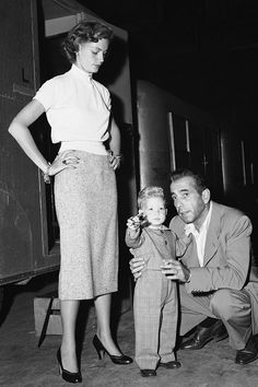 Stephen Bogart, not yet two years old, learns about movie making from his dad, actor Humphrey Bogart, along with his mom Lauren Bacall, circa 1950 - Lauren Bacall's Best Fashion Looks Through the Years - Style Photos of Lauren Bacall - Elle
