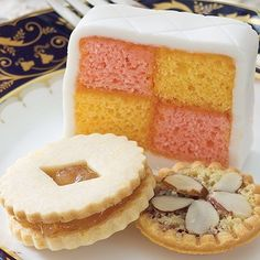 """While the #British monarch's #birthday is traditionally celebrated in June, #QueenElizabeth was born on April 21 1926. What could be a more fitting way to honor her birthday than with #cake, like this Strawberry-Lemon Battenberg Cake? And since tomorrow is also #NationalTeaDay in the UK, try this sweet with a pot of Capital Teas's """"Darjeeling 1st Flush Poobong FTGFOP1."""" Click the link in our bio for the recipe. #AfternoonTea"""
