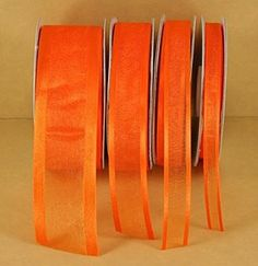 """The Orange sheer ribbon is 5/8"""" inches wide and is 25 yards long and has a satin edge. The orange sheer ribbon is perfect for gift wrapping, wedding decor, decorating cakes and more. This sheer ribbon"""