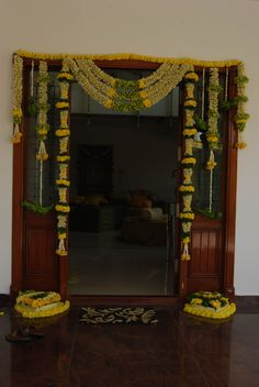 Simple Flower Decoration For Villa For Housewarming, Gruhapravesam . Door Flower Decoration, Decoration Hall, Decoration Entree, Entrance Decor, Flower Decorations, Wedding Entrance, Beautiful Decoration, Gauri Decoration, Mandir Decoration
