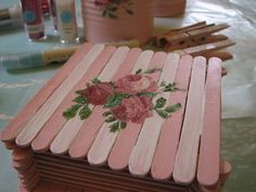 a pretty popsicle stick box covered in glittered roses