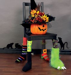 Look...you can make monster or witch legs for your dining room chairs for Halloween!