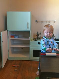 DIY - kid's kitchen out of an old TV cabinet