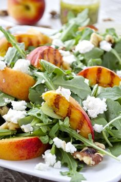 A picture perfect salad with summer's best produce! This grilled peach and arugula salad comes together quickly, but packs a big flavor punch. Drizzle it with my delicious homemade mint vinaigrette for a refreshing meal!substitute pecans for walnuts Grilled Peach Salad, Grilled Peaches, Vegetarian Recipes, Cooking Recipes, Healthy Recipes, Healthy Eats, Eating Healthy, Vegetable Recipes, Delicious Recipes