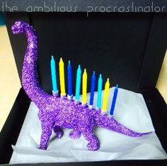 DIY Glittered Brontosaurus Menorah... Haha this is awesome... If I were Jewish