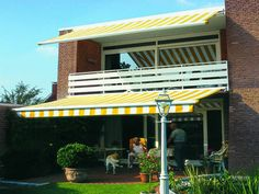 M990 patio awning has been developed for the new millennium by Schmitze-werke, the renowned German awning manufacturer for special applications where the fixing is limited only to the ends of the awning for example over a patio.