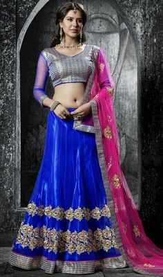 Transform from the girl next door to a stylish diva dressed in this blue net embroidered choli skirt. The ethnic lace, patch, resham and stones work in the attire adds a sign of attractiveness statement for your look. Lehenga Online Shopping, Indian Navel, Saree Models, Party Wear Lehenga, Sexy Hips, Half Saree, Indian Attire, Western Outfits, Indian Girls