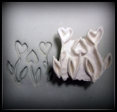 This is hand carved heart flowers patterned stamps, made out of high fired stoneware clay.   This stamp is great for just one impression or a complete