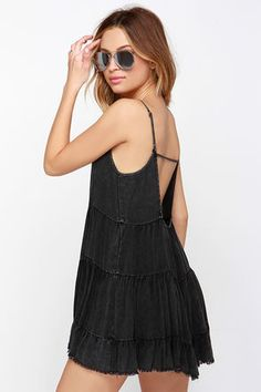 If you got it, you better flaunt it with the Bare Mini-mum Washed Black Dress! The softest woven rayon shapes a cute triangle bodice with adjustable spaghetti straps atop the wide-cut bodice. Seams descend the mini-length skirt to create a cute ruffled look (finished with raw hems). Open back is finished with single strap accent. Unlined. 100% Rayon. Hand Wash Cold. Imported.