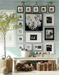 Pottery Barn...display wall & bench, love the blue painted paneling