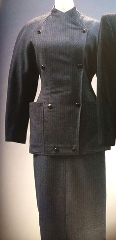 Anne-Marie Beretta Suit. Label: ANNE BERETTA PARIS c.1983.Pin-stripe wool flannel jacket and skirt; patch pockets; slit at skirt-front.