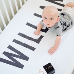 Baby William hanging out on his personalized crib sheet #woolfwithme