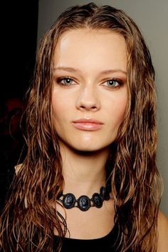The natural lips and base makeup is a good foundation to work upon for the brunette model.   The wet look hair would work great for the red haired model