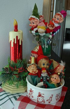 Christmas elves from the 60's and cardboard candle light. {I own these : )   }