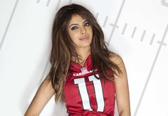 Priyanka Chopra shows off her football style by modeling outfits for each NFL team.