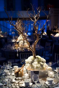 Love this centerpiece but with flowers in the tree too