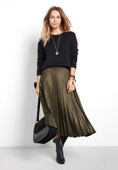 "Add a gorgeous shimmer to your look with this metallic pleated midi skirt. The striped elasticated waistband adds a unique finish, just tuck in our Erica Knit top. •Easy, straight fit. Try your usual size. •Pleated. •Elasticated waist. •Mid rise, sits at your natural waist. •Model is 5'7"" and wears size XS."