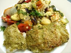 Pesto crusted cod with roasted vegetable giant couscous.