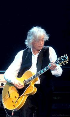 Jimmy Page performing at the Ahmet Ertugen Tribute Concert at the O2, December 10th, 2007. Click on pin for gif