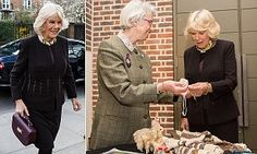 OAP SPINS WOOL FROM HER DOGS COAT.......The Duchess of Cornwall, 68, joined other pensioners today at The Geffrye Museum in Hoxton, London, for GrandFest, a festival celebrating the skills of the over-70s.
