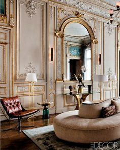 I love the modern chair in the antique room