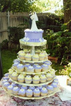 Wedding Cupcake Stand - The tiers are glass rounds with crystal candlesticks as the columns between each layer.  The top is a silver cake stand This holds about 150 cupcakes.