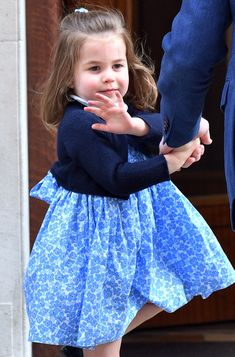 Charlotte showed off her royal wave for the crowd.