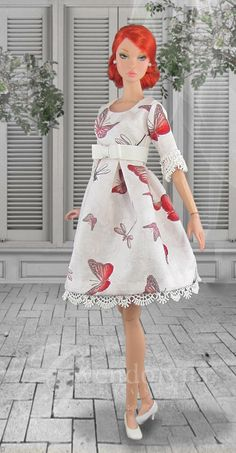 Delicate white butterfly print summer dress for Poppy has a lined bodice with Empire waist and bow , box pleated skirt, and lace trim on the sleeves and hemline. Dress has snap back closure. Doll, shoes and jewelry are not included. Dolly Dress, Barbie Dress, Barbie Clothes, Beautiful Barbie Dolls, Pretty Dolls, Barbie Fashion Royalty, Fashion Dolls, Vintage Barbie, Vintage Dolls