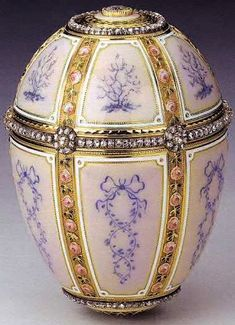 Kelch 12 Panel Egg (or Gold, Enamel and Jeweled Egg, orCelebration Egg), 1899. Presented by the industrialist Alexander Kelch to his wife Barbara (Varvara) Kelch-Bazanova. Gold & diamonds. Kept in The Royal Collection, Her Majesty Queen Elizabeth II