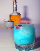 Frostbite    1 1/2 oz tequila  1/2 oz white crème de cacao  1/2 oz blue curaçao  1/2 oz cream  maraschino cherry for garnish