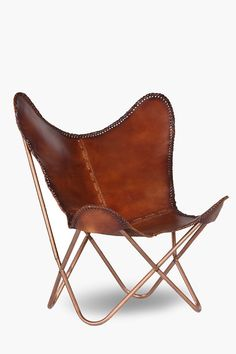 Add a touch of class to your home with this butterfly leather chair. The leather seat is supported by a tubula, copper frame. Leather No assembly required. Red Accent Chair, Teal Chair, Pink Chairs, Arm Chairs, Home Online Shopping, Home Decor Online, Barber Chair Vintage, Leather Butterfly Chair, Small Swivel Chair