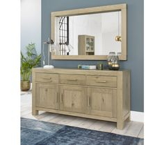 Featuring three doors and three drawers, the Turin Aged Oak Wide Sideboard maximises your storage space and is both practical and stylish. With strong and refined linear handles, the natural warmth of the aged oak finish beautifully enhances this sideboard. Combine modern design with practicality for a style-conscious dining space.