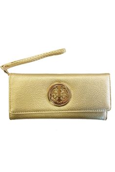 """Bright gold medallion wallet with a wristlet strap for easy carrying; carry under your arm or on your wrist. The strap is removable. This is the chicest shade of gold to pair with white skinnies or a sundress. It would look fab under your arm at a summer wedding. The inside of the wallet contains tons of compartments to hold all of your cash and cards, even change! There are 12 credit card slots. The wallet is 7.75"""" long, 4"""" high, and approximately 1"""" wide.   Gold Medallion Wallet Bags…"""