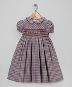 Every now and then a dress comes along that's so irresistible that it begs for a few snapshots. Crafted with gathered sleeves, a Peter Pan collar and wide flowing skirt, this sweetly smocked frock offers an angelic look that's picture-perfect.