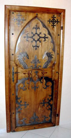 """Scandinavian Door w/old style / or old designs / dragons -- the symbol on the upper right and left may be what I saw in a few Stave Kjirke's which had a MEANING of saying """"WE ARE HERE, BUT WE DON'T BELIEVE THIS"""" because Christianity was ENFORCED. by King Richard I think -- It was Mandatory. Vikings are sensible, true to self, hard to manipulate, and stubborn. :-D"""