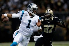 NEW ORLEANS, LA - DECEMBER 08: Cam Newton #1 of the Carolina Panthers is tackled by Malcolm Jenkins #27 of the New Orleans Saints at Mercedes-Benz Superdome on December 8, 2013 in New Orleans, Louisiana. (Photo by Chris Graythen/Getty Images)