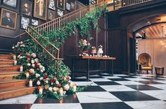 floral covered staircase / photography: Papered Heart Photography // venue: Oxford Exchange Tampa, Florida // florals: Botanica International Design Studio